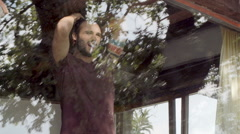 Young beautiful man look outside throw window  slow motion Stock Footage