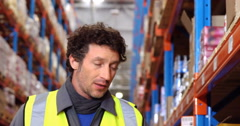Warehouse worker looking the shelves Stock Footage