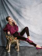 beauty rich brunette woman in luxury interior near empty frames - stock photo