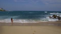 WOMAN SURF INDIAN OCEAN BEACH TANGALLE SRI LANKA - stock footage