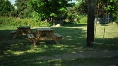 Picnic Tables and Swings, L to R pan - stock footage