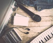 Set of audio device on wooden background Kuvituskuvat