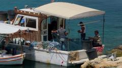 FISHERMEN UNTANGLE NETS KARPAS PENINSULA CYPRUS Stock Footage