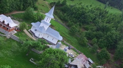 Christian church on top af a green hill, aerial flight Stock Footage