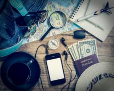Set of travel accessory on wooden background Stock Photos