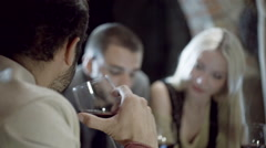 Detail of man in a group of friends drinking wine in rural farm house Stock Footage