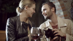 Close up of couple in love smiling and playing with cat in rural farm house Stock Footage