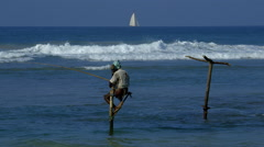 LONE STILT FISHERMAN YACHT WELIGAMA SRI LANKA ASIA - stock footage