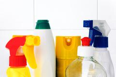 Top of bottles with cleaning products - stock photo