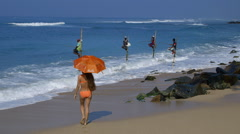 STILT FISHERMEN MODEL UMBRELLA MIDIGAMA SRI LANKA Stock Footage