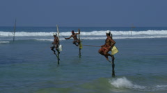 STILT FISHERMEN SURF WELIGAMA SRI LANKA ASIA - stock footage