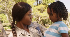 Soldier mother holding his son in a park Stock Footage