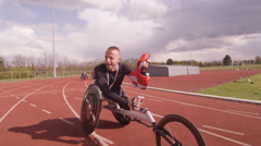4K Winning disabled athlete at racing event doing victory lap with British flag. Stock Footage