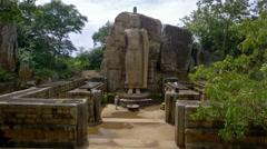 AUKANA BUDDHA STATUE FEET TOURIST SRI LANKA Stock Footage