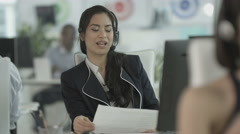 4K Customer service operator with headset talking to customer in call center Stock Footage
