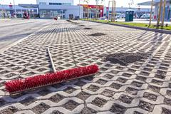 Cleaning new parking place with red broom - stock photo