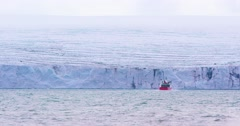 Expedition boat in front of a massive glacier - stock footage