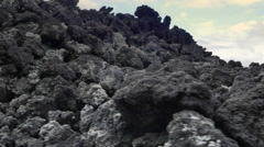 Volcanic lava rocks and grey ash in deserted land of volcano caldera - stock footage