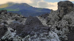 Ash and volcanic rocks in Batur national park. Adventure travel to Indonesia - stock footage