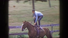 1956: Teenage boy riding horse standing up smoking cigarette cocky showboat. Stock Footage