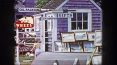 1955: Mother son shopping at country crafts gift store yard decorations. Stock Footage