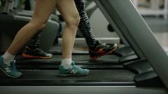 Woman's legs walking on treadmill Stock Footage