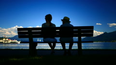Mother daughter relaxing in Prien Chiemsee lake Germany Stock Footage