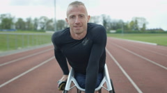 4K Portrait of smiling disabled athlete in specialist wheelchair at racing track Stock Footage