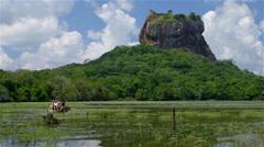 LION ROCK ELEPHANT RIDE LAKE SIGIRIYA SRI LANKA Stock Footage