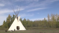 Clip of a TeePee in a field. Suitable for background use. Stock Footage