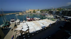 HARBOUR BOATS RESTAURANTS KYRENIA NORTHERN CYPRUS Stock Footage