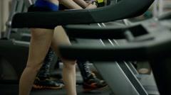 Pretty smiling blond woman walking on treadmill - stock footage