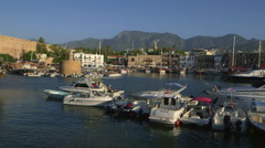 BOATS IN HARBOUR MOUNTAINS KYRENIA NORTHERN CYPRUS Stock Footage