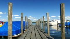 4K Motor sail boat mooring at wooden bridge in Prien Chiemsee lake Germany Stock Footage