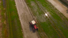 Aerial view Vietnam tractor rice fields Stock Footage