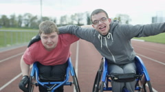 4K Portrait of smiling disabled athletes in wheelchairs at racing track - stock footage
