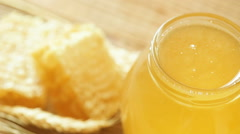 Honey in a jar with wheat and honeycomb Stock Footage
