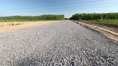 Unfinished asphalt country road Stock Footage