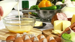 Cooking omelet. To add the beaten egg and milk mix blender - stock footage
