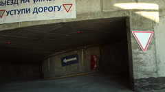 The car goes through a multi-storey overground parking Stock Footage