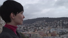Portrait woman at vacation holiday looking on the city view Stock Footage