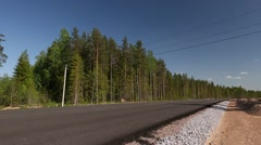 New asphalt country road in the forest - stock footage