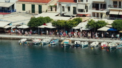 Top view to the moored boats, walking tourists. Stock Footage