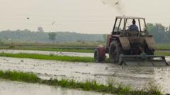 Vietnam tractor rice fields 2 Stock Footage