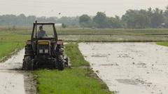 Vietnam tractor rice fields Stock Footage