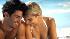 Affectionate young couple on beach Stock Footage