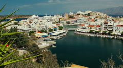 Pan, top view to colorful greek town Agios Nikolaos.  Tourism concept. Stock Footage