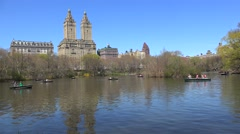 Rowboats at the Lake oft NYC Central Park and San Remo apartments on background Stock Footage