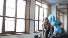 Girl does deadlift with straight legs and a barbell Stock Footage