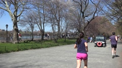Pedestrians and  joggers on the East Drive of the NYC Central Park Stock Footage